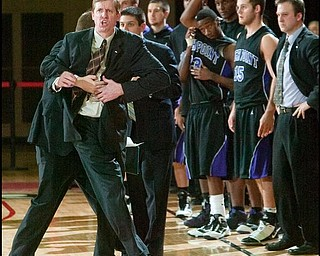 The Vindicator/Geoffrey HauschildHigh Point University's Head Coach Scott Cherry yells after disagreeing with a ?foul during the second half of a game at Beeghley Center on Tuesday evening.