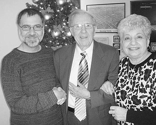 """Special to The Vindicator HOLIDAY EVENT: Salem Historical Society installed officers for 2010 during its December meeting. David Shivers, at left, congratulates Lou Raymond, newly installed president, and Judi Allio, who was installed as vice president. Their associate officers will be Judy White, recording secretary; Dixie Gordon, corresponding secretary; Lisa M. Baird, treasurer; Steve Faber, Kevin Shafer and Virginia Wilms, three-year trustees; Janice Lesher, curator; and David Stratton, director. A program, """"Holiday Traditions,"""" was presented by Christopher Kenney, educational director at the McKinley Museum in Canton. The society will participate in First Night Salem activities by displaying a variety of lights. Anyone interested in lending a light for the display is asked to contact (330) 337-8514."""