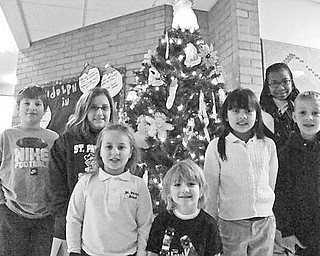 Special to The Vindicator ST. PATRICK SCHOOL: Students at St. Patrick School in Hubbard got into the holiday spirit by collecting $200 to be donated to the Cystic Fibrosis Foundation to help those who are suffering from the disease. Participating in the project are, above from left, Daniel Robinson , Kelly Wylodsky, Katie Cioggle, Jayden Johnson, Samantha Rosser, Maryam Dennis and Daniel Yoder.