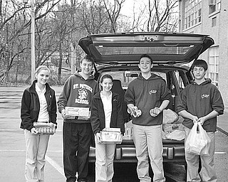 Special to The Vindicator END OF DRIVE: The eighth-grade class at St. Patrick School has completed a series of drives during which food was collected for the St. Vincent de Paul Society Food Bank at St. Patrick Church in Hubbard. Above from left, Emily Frazzini, Joe Sebest, Alexandra Colacino, Nick Ezzo and Vince Seffera show a few of the items they helped to collect and to deliver to St. Vincent de Paul along with a check for $100 to be used to purchase additional food for the needy.