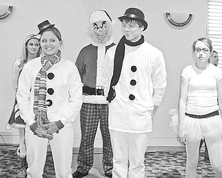 Special to The Vindicator DRESSED FOR EVENT: Members of the Austintown High School Choir performed songs and dances to entertain the Friends of Austintown Library. The public is invited to the next Friends meeting, at 10 a.m. Jan. 11 at the library. Speaking at the meeting will be Bertram de Souza, editorial writer for The Vindicator.  He will discuss the political scene for 2010 and the importance of the 2010 census and how it may affect Youngstown and the Mahoning Valley.