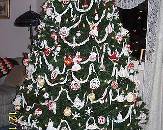 Judith Ferrett likes to crochet and decided to make all the ornaments for their Christmas tree, which includes angels, snowmen, bells, framed family pictures, strands of garland of faux pearls, snowflakes, candy canes, beaded icicles. She also crocheted the tree skirt. This is a work in progress as she adds to it each year.