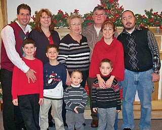 The Pappagallo family includes: left, Andy Jr., Carrie and their sons, Matthew, 8 and Jacob, 6; middle, Sandy and Andy Sr. (grandma and grandpa); and right, Natalie, Tim Sr. and their sons, Dominic, 3, and Tim Jr., 5.
