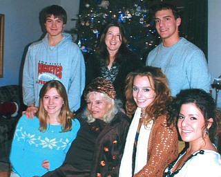 Joanne Speece of Canfield, seated, is surrounded by her grandchildren, seated from left, Leanna Hartsough of Canfield, Angela Speece of Boston and Jessica Speece of North Jackson, and, standing from left, Aaron Hartsough, great-grandson, Heidi Van Auker of Canfield and Billy Speece of North Jackson.
