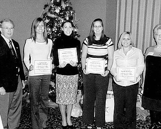 Special to The Vindicator FUTURES IN EDUCATION: The Mahoning Retired Teachers Association met Dec. 10 at Antone's Banquet Centre in Boardman. Four senior education majors from Youngstown State University received awards of $1,000 each. From left to right are MRTA President Robert Thomas, Caitlin Dorbish, Brittany Hopper, Khristine Krcelic, Nicole Burlock, and Bernadette Hogg, the scholarship chairwoman.