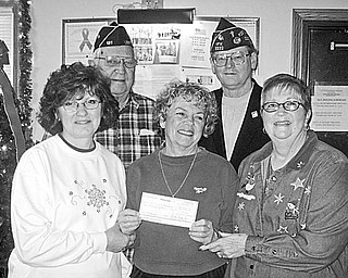 Special to The Vindicator GIFT GIVING: St. Vincent de Paul Food Pantry of St. Patrick Church in Leetonia received a check for nearly $750 from Washingtonville VFW Post 5532 on Dec. 16. In front above, Susan DeJane, treasurer, and Edie Binder, secretary, of St. Vincent de Paul Food Pantry, accept the donation from Ruth Pratt, president of VFW Post 5532 Ladies Auxiliary. Also pictured are Jim Stewart, finance officer of American Legion Post 131 of Leetonia, and Commander Paul Kramer of the VFW, who assisted in raising the funds.