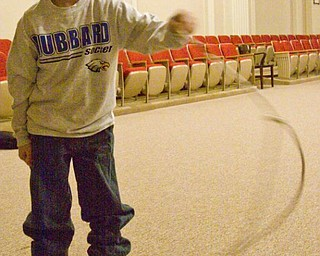 The Vindicator/Lisa-Ann Ishihara --- Robbie Gessler (8) of Coitsville Township gets a free rope for volunteering during Richard and Donna Best's Black Lightning Wild West Showon the second floor of the Masonic Temple during First Night Youngstown 2010