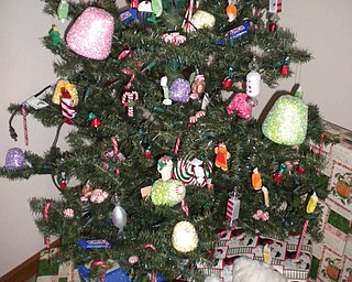 Paulina Montaldo of Canfied says the decorations on the family Christmas tree are different every year.This year is their candy tree — with fake and real candy!