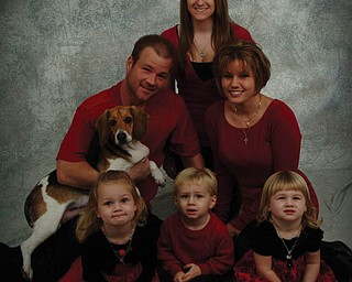 In this Bowers family pyramid (resembling a tree, of course) are, front from left, Brelyn, 4, Hadyn, 2, and Kaelyn, 2; middle, Brandon (father), holding Trinity, the family puppy, and Jackie (mother); and, top, Victoria Reighart (Jackie's sister).