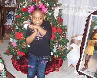 Charnae Mitchel spent Christmas Eve at the home of her great-grandmother, Sandra Allen Bowman of Youngstown.