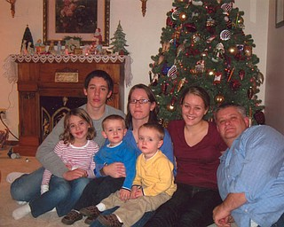 """Spending Christmas at """"Grandma Beth"""" Hatalsky's home in Mineral Ridge, were, from left, Ryan; mom, Catherine; Bethany; dad, Don; Anna; and twins, Mark and Sean, from Olmsted Falls."""