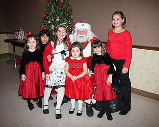 Among those getting to meet Santa at the annual Menichini family Christmas Eve celebration this year were: Maria and Mia Mangine, Kate Coppola, Lily and Carli Vari-Coppola and Chloe Simmerman, all of Lowellville.