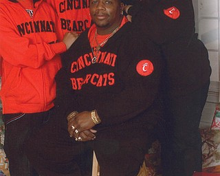 The Poindexters — Lil Allen, Dontrel, Allen Sr. and Debbie — of Youngstown pose in front of their Christmas tree.