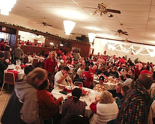 The Vindicator/Lisa-Ann Ishihara -- Aulizio's Banquet Center in Warren during the free christmas dinner