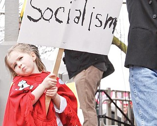 """Jordan Bennett (4) holds a sign in Lisbon Square for Lisbon's Tax Day Tea Party to protest Washington's """"socialist"""" direction, Wednesday April 15, 2009Lisa-Ann Ishihara"""