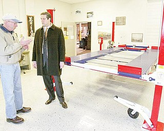 Larry Gross owner of Backyard Buddy in Warren talks with Congressman Tim Ryan Monday at Gross's showroom on Dana Streer in Warren. Gross says cheap imports from China have hurt his business.