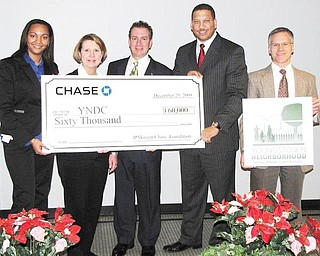BANK GIVES BUCKS: JP Morgan Chase Bank donated $60,000 to Youngstown Neighborhood Development Corp.'s homeownership and Lots of Green programs. YNDC was launched in February 2009 in partnership with the city of Youngstown and Raymond John Wean Foundation. From left are Cinnamon Pelly, Deborah Eppinger and James Pitzer, all of JPMorgan Chase; Presley Gillespie, YNDC executive director, and George Garchar of YNDC.