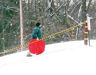 SNOW FUN: Children don't drive in snow, but they do like to go sled riding, and a popular spot to do so is the sledding hill at Mill Creek MetroParks' James L. Wick Recreation Area on Youngstown's West Side. The new year has produced a lot of the white stuff, but forecasters predict near-normal temperatures and below-average precipitation totals for the first three months of 2010.