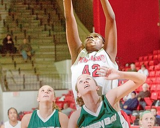 SECOND EFFORT: Youngstown State's Brandi Brown (42) rises above Green Bay's Kayla Tetschlag (42) and Adrian Ritchie (13) during the first half of Monday night's game at YSU's Beeghley Center. Brown finished with a team-high 16 points and nine rebounds — one short of earning her fifth double-double.