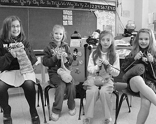 Special to The Vindicator YOUNG KNITTERS: Students at St. Patrick School in Hubbard are learning a hobby that will make the wintry days warmer for some area residents. Under the tutelage of Elaine Scott, a first-grade teacher, they belong to an after-school knitting club. It meets once a week and is open to all grades and to parents. The youngsters already made seven scarves, which will be donated to the Rescue Mission. Among those enjoying the needlecraft are, from left, Kelly Wydolsky, Kayla Beil, Nicole DeLuca and Carly Siciliano.