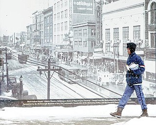 WINTER WHITE: Though the holidays are over, the winter snow season has just begun. Snow has been falling in the Mahoning Valley for several days now, and forecasts show no sign that it will let up over the next week. Leslie Glover, who delivered mail on foot in downtown Youngstown Tuesday, said she's been doing the job for 24 years and doesn't mind the weather.