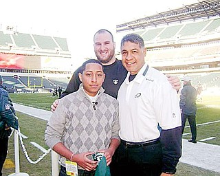 SPECIAL TRIP: Angelo Astorga, left, traveled to Philadelphia to see an Eagles game Dec. 27. While there, he got to meet some players. With him is Eagles offensive lineman Mike McGlynn, center, and the team's offensive line coach Juan Castillo.