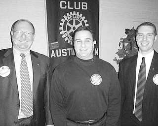 Special to The Vindicator SOMETHING NEW: Vince Colaluca, superintendent of Austintown Schools, is flanked by Rotarian Chuck Baker, at left, and Brian Laraway, club president, following his induction into membership at the Jan. 4 meeting of the Rotary Club of Austintown. In addition to the installation ceremony, a program was presented by Deanna Hosey, owner of the Something Unique For You shop on Mahoning Avenue. Hosey was a high school exchange student to Japan through Austintown Rotary, sponsored by Dr. Murphy Morgan. She spoke of her efforts to make flowers affordable for everyone and of her recovery from a fire last year at her shop.