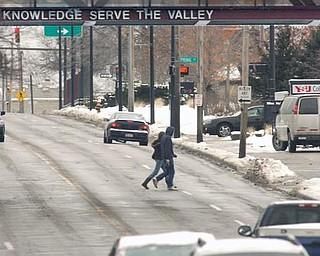 Pedestrians make their way down Wick Avenue.