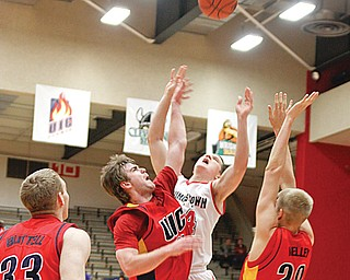 SEASON HIGH: Youngstown's State's Vytas Sulskis (44) shoots over UIC defenders Jeremy Buttell (33), Spencer Stewart (25) and Anthony Kelley (20) during the first half of Thursday's game at Beeghly Center. Sulskis tied a season-high 17 points in the Penguins' 76-67 win over the Flames.