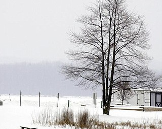 A lone picnic bench covered in snow and cold at Mosquito Lake State Park in Cortland.