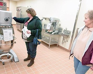 Tammy Swank, and mother, Gloria Damron, inspect a new kitchen area at the MCCTC on Sunday afternoon. Tammy's son, Ryan, has been enrolled at MCCTC for two years currently studying horticulture and carpentry but may also take culinary classes.