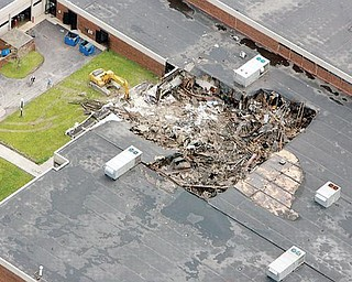 DAMAGE: An aerial view shows extensive damage a fire in May 2007 caused to the Mahoning County Career and Technical Center. The center dedicated renovations and a new wing at the school Sunday.