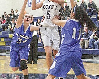 Ashley Moore (5) goes to the hoop as (34) Alexis Pizzulo and (11) Sofia Accordino play defense during their game Monday night.