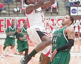 YSU DeAndre Mays (1) scores two against Cleveland State's Aaron Pogue (44) during the first half of a game at YSU's Beeghley Center on Saturday evening.