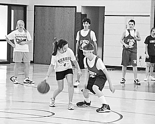 Special to The Vindicator GAME PLAN: Students at St. Patrick School in Hubbard had a goal in mind when they arranged a benefit basketball game for Dec. 18. Above are some of the seventh- and eighth-grade boys and girls as they played the game. The entire student body also became involved in the fundraising event. Each student paid a dollar not to wear a school uniform that day and spent the morning cheering for their favorite players. Family members made a donation at the door when they came to watch the game. As is their tradition, the seventh-and eighth-grade classes donated the proceeds netted from the event to a family from the school that experienced adversity during the past year.
