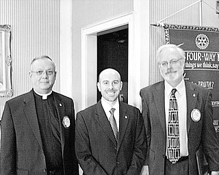 Special to The Vindicator RECOGNIZED:  Four members of Youngstown Rotary Club were singled out for recognition at the club's Jan.6 meeting. Each received a Paul Harris Fellow award in appreciation of their assistance in furthering friendly relationships among the people of the world. Three of the recipients are, above from left, Monsignor Robert Siffrin, Mark Mazzella, CPA, and Atty. Jim Blomstrom. The other recipient, not pictured, is Carlton Sears, director of Mahoning County Library. The program was presented by District 6650 Governor Douglas Simpson and Dallas Woodall, who spoke about the Rotary International Foundation, which sponsors such things as safe water projects in developing countries and promotes education and fellowship throughout the world.