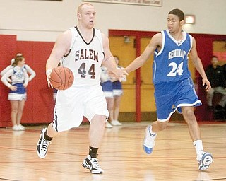 MOVING UP THE FLOOR: Salem's Mike King dribbles upcourt past Poland's Ben Donlow during the third quarter of Tuesday's game at Salem High School.