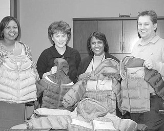Special to The Vindicator WARMING TREND: A $1,000 donation approved by the executive board of Boardman Rotary Club and skillful bargain-shopping by Rotarian Ryan Cuffle resulted in the purchase of 58 brand-new winter coats for children in the MYCAP Head Start program. Cuffle took the donation to Kohl's, where he opened a credit card account, giving him an additional 10 percent off purchases, used a 30 percent off code provided by a fellow Rotarian, and received an additional $160 Kohl's cash on the original purchase of the coats. Showing some of the gift coats are, above from left, Kavon Wright, manager of Head Start Family Service; Judy Miller, assistant director of Head Start; Lois Clark, director of Head Start; and Cuffle.
