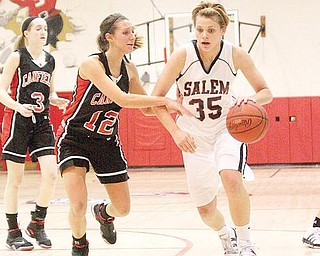 1,000 POINT MILESTONE: Salem's Amy Scullion (35) drives to the hoop as Canfield's Kendal Malsch (12) defends during Wednesday's game at Salem High School. The Cardinals' 58-48 victory spoiled an historic night for Scullion, an Ohio State recruit, who passed 1,000 career points.