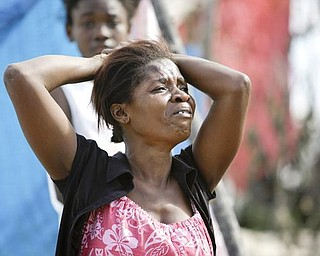 A woman cries after finding the body of a loved one after the earthquake in Port-au-Prince, Wednesday, Jan. 13, 2010. A 7.0-magnitude earthquake hit Haiti on Tuesday.