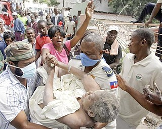 Gladys Loiuis Jeune is pulled alive from the rubble of her home in Port-au-Prince nearly 43 hours after Tuesday's earthquake, where she was greeted by her a cheering crowd Thursday, Jan. 14, 2010.