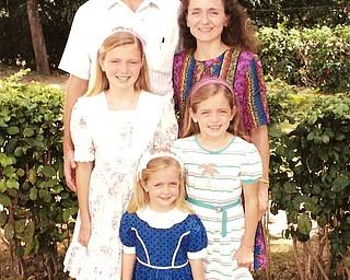 The Agnew family, in Bonne Fin, Haiti around 1994. Scott Agnew, M.D., wife Sandi Agnew, daughters Kristen, Jenna, Lauren.