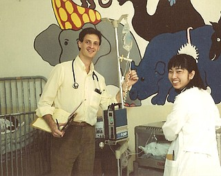Scott Agnew, M.D. in Pediatrics ward with medical student at Hôpital Lumière (the Hospital of Light) in Bonne Fin, Haiti, about 100 miles west of Port-au-Prince.