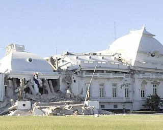 Haiti's National Palace is seen damaged in Port-au-Prince, Wednesday, Jan. 13, 2010.  A powerful earthquake struck the country on Tuesday.