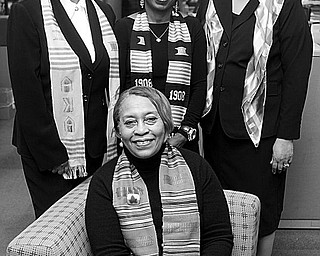 The Vindicator/Geoffrey Hauschild LADIES IN WAITING: Satisfied that arrangements have been completed for the Black and White Snowflake Ball, to be sponsored by the Epsilon Mu Omega Chapter of Alpha Kappa Alpha Sorority, are, seated, Sarah Brown-Clark, member of the program committee; and standing from left, Beverly Fortune, chair of the event; Robin Bradley, ticket chair; and Carole Staten, technology chair.