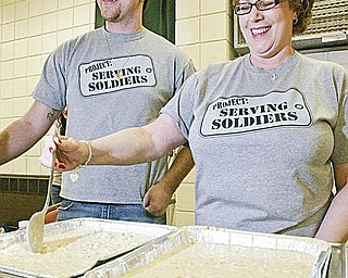 PROJECT CHILI COOK-OFF: Zack Lord and his mom, Karen Lord, both of Hubbard, stir a batch of their white-chicken chili. The Lords are a part of Project: Serving Soldiers, a service organization that helps soldiers overseas.