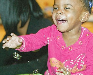 GAME TIME: Lyric Saulsberry, 2, plays a game at the citywide baby shower at the McGuffey Centre in Youngstown. She attended the event Monday with her mother, Latasha Saulsberry of Youngstown. It was the 4th annual citywide baby shower sponsored by the Associated Neighborhood Centers' McGuffey Centre.