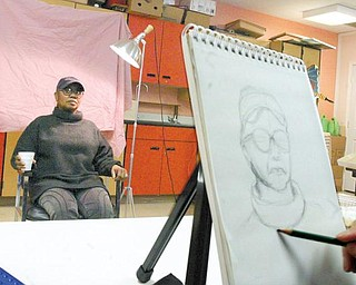 PRACTICING THEIR ART: Artists from the Trumbull Art Gallery gather every Tuesday morning at the SCOPE Center in Warren for a portrait session. They've been meeting since 1981. Gail Brady, of Warren, happened to be at SCOPE on Tuesday and volunteered to sit for them.