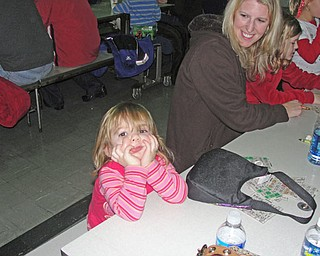 Delaney Gallagher, 2, waits patiently for mom Richelle and sister Mikayla, 8, to fill out their bingo cards.