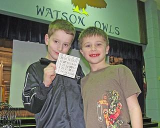 Alex Miller, 8, celebrates his bingo victory with classmate Lorenzo Russo, 8.
